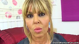 UK milf Gabby Fox teases us in long boots and fishnet tights