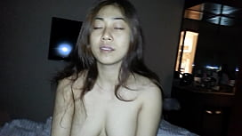 Busty Vietnamese chick riding cock in hotel room