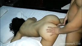 Asian prostitute gets banged by two guys in a hotel