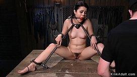 Sexy brunette slave Yhivi locked in metal device bondage with immobilized neck and wrists and ankles waits for master