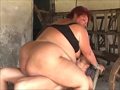 Fat redhead mature fucked by a young guy