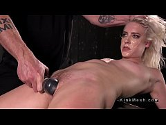 Restrained in devices blonde gagged and flogged