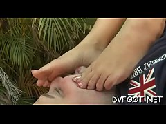 Hot playgirl shows off sexy feet and sucks her own toes