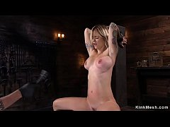 Alt busty slave beauty in wooden bondage tron fucked with dick on a stick