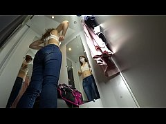 A hidden camera spies on a sexy girl in a public locker room at the mall, gorgeous ass and long legs, bottom view.