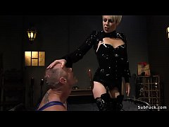 Blonde Milf in black rubber lingerie makes muscular dude in bondage lick her pussy in face sitting