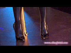 Latex stockings clad blonde in 6 inch stiletto high heels