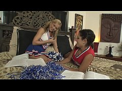 Playful cheerleaders Missy Maze and Ashley Abott like to talk to the canoe driver