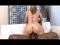 Blonde housewife Sara Jay enjoys being oiled and drilled by horny black fellow Rock