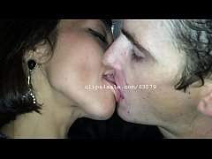 A Sexy Woman Kissing a Younger College Teen