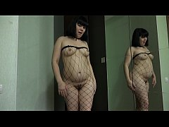 Girl fucks a hairy pussy with a bottle of deodorant, home masturbation in front of a mirror.