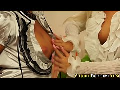 Clothed lesbians toying