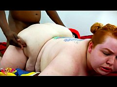 Black guy Fucks plump young ginger hard from behind