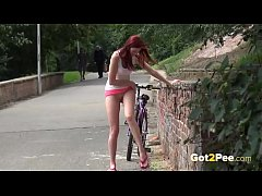Public Peeing - Kattie Gold takes a break in her bike ride to piss against a wall