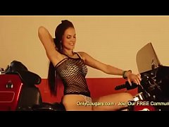 Sexy Brunette Doing A Striptease On A Chopper - Softcore