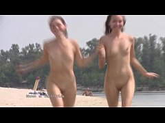A public beach heats up with two hot teen nudists