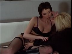 Sexy lesbians fuck each other with toys and strapon