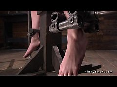 Brunette slave Casey Calvert  in device bondage getting whip