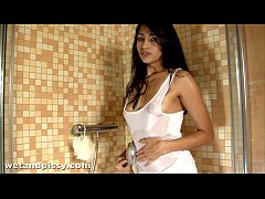 Exotic babe Ruth sprays her warm golden piss in the shower