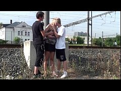 Cum on a MILF face in PUBLIC street threesome sex by a train station
