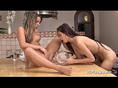 Lesbian lovers drench each others tight pussies