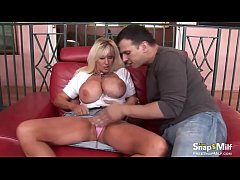 Horny blonde milf delly with huge boobs gets her pussy fucked on the red couch