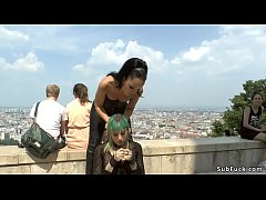Green haired European slave Lola disgraced and shamed by mistress Fetish Liza and master John Strong in Budapest streets