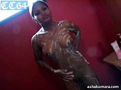 Dusky and sexy Asha Kumara stripping naked and taking shower