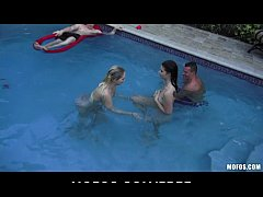 Two slutty skinny dipping girlfriends start orgy at a pool party