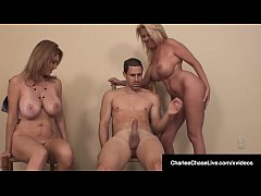 Sexy Big Boobed Milf Charlee Chase hires a stripper for her husband who fucks both Charlee & the stripper in their tight wet cunts in this hot threesome!
