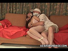 Asian slut is getting roped up and treated to a...