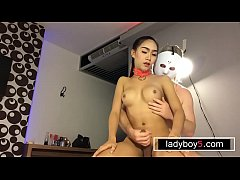 Teenie ladyboy with her hands tied up blowjob action