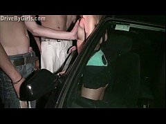 Young blonde teen girl is undressing in a car on the way to public gangbang orgy