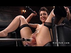 Solo brunette babe Lilith Luxe in stockings masturbates with Hitachi in chair then gets double penetration fucking machine