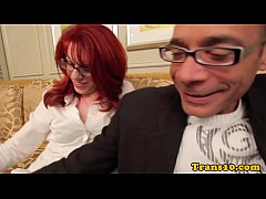 Redhead tgirl in stockings and spex
