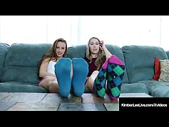 Auburn haired Kimber Lee & Foot Loving Lesbian Ashlynn Taylor remove their stinky socks & display their cute soles, peds, toes & feet to make you want a foot job!