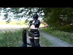 A man takes a walk with his special pet: a hot girl in latex and chains